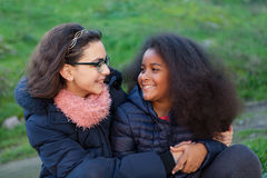 Two happy girls in the park Royalty Free Stock Photos
