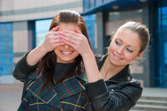 Two happy girls play on a street. Two playful happy girls on a street Stock Images