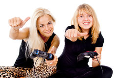 Two happy girls play video games. Isolated on white background Royalty Free Stock Photos