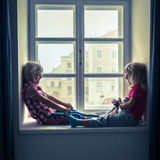 Two happy girls playing Stock Images