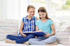 Two happy girls reading book at home Royalty Free Stock Photography