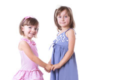 Two happy girls sisters holding by hands Royalty Free Stock Images