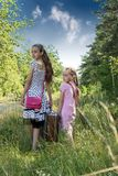 Two happy girls with suitcase on railways Royalty Free Stock Photography