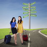 Two happy girls with suitcases Stock Image