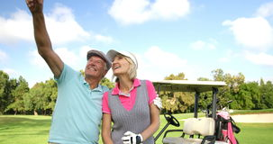 Two happy golfer standing together stock video