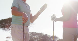 Two happy golfers giving high five stock footage