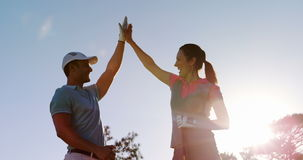 Two happy golfers giving high five. At golf course stock video
