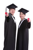 Two happy graduates student Stock Photo