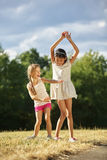 Two happy grils dancing royalty free stock photography