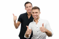 Two happy guys. Good mood. Joy and smiles. Two attractive guys in the studio. Business and education. Technology and sport stock images