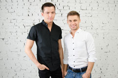 Two happy guys. Work and leisure. Two attractive guys in the studio. Business and education royalty free stock photos