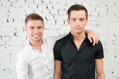Two happy guys. Work and leisure. Two attractive guys in the studio. Business and education royalty free stock photography