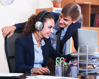 Two happy help line operators Royalty Free Stock Image