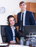 Two happy help line operators Stock Photos