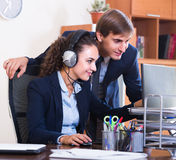 Two happy help line operators Royalty Free Stock Photo