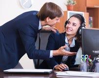 Two happy help line operators Stock Image