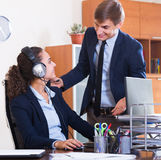 Two happy help line operators Royalty Free Stock Photo