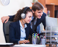 Two happy help line operators Stock Images