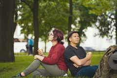 Two happy hikers eating ice cream in the summer park. Telephoto shot Royalty Free Stock Photography