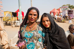 Two happy indian women possing on the village street Stock Photos