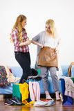 Two happy female friends after shopping. Two happy joyful women having fun after shopping, picking outfit in closet. Female friends fooling around royalty free stock image