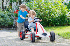 Two happy kid boys having fun with toy car Royalty Free Stock Photo