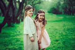 Two happy kid girl playing together in summer, outdoor activities. Friendship concept stock images
