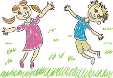 Two Happy Kids. Jumping for joy outside in the grass Royalty Free Stock Image