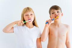 Kids brushing teeth Stock Photos