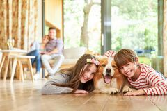 Free Two Happy Kids Cuddle Up With Their Dog Stock Photo - 178522290
