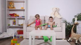 Two happy kids in diving mask sitting together in sofa.  stock video