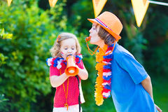 Two happy kids Dutch football supporters Royalty Free Stock Photography