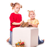 Two happy kids with easter bunny and eggs. Happy Easter Stock Photos