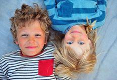 Two happy kids faces top view stock photos