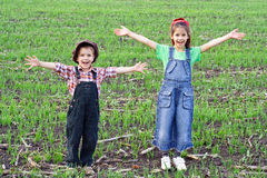 Two happy kids in the field Stock Photography