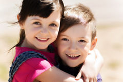 Two happy kids hugging outdoors Royalty Free Stock Photo