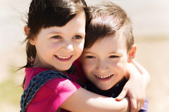 Two happy kids hugging outdoors Stock Photo