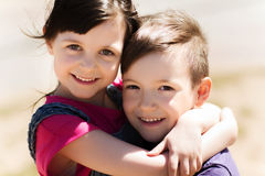 Two happy kids hugging outdoors Royalty Free Stock Image