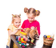 Two happy kids painting easter eggs. Happy Easter Royalty Free Stock Image