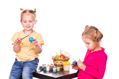 Two happy kids painting easter eggs. Happy Easter Royalty Free Stock Photography