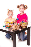 Two happy kids painting easter eggs. Happy Easter Royalty Free Stock Images