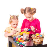 Two happy kids painting easter eggs. Happy Easter Stock Image