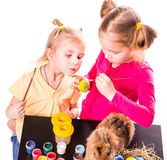 Two happy kids painting easter eggs. Happy Easter Stock Photos