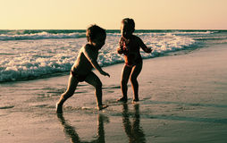 Two happy kids playing on the beach Royalty Free Stock Images