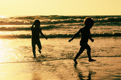 Two happy kids playing on the beach Royalty Free Stock Photos
