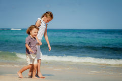Two happy kids playing on beach Royalty Free Stock Photography