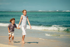 Two happy kids playing on beach Stock Photography