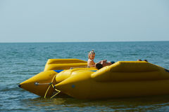 Two happy kids playing on the boat at summer day Stock Photo