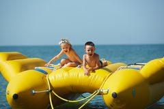 Two happy kids playing on the boat at summer day Stock Photos
