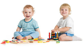 Two happy kids playing logical toys Stock Image